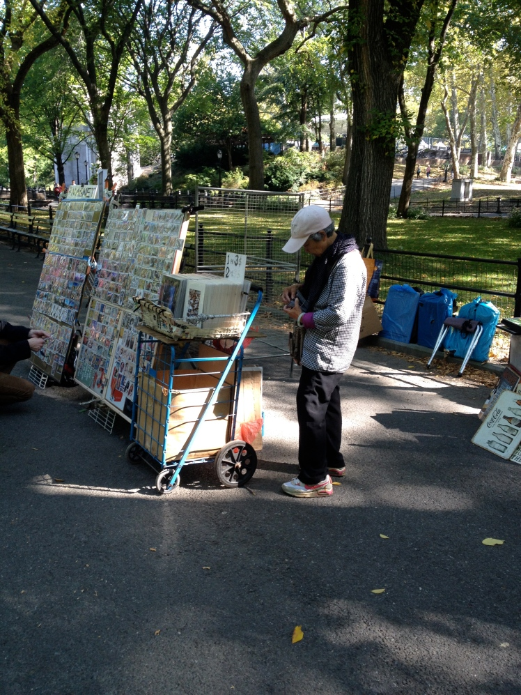 An old lady selling magnets